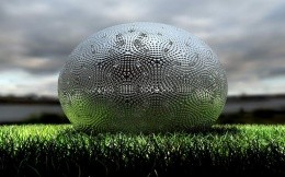 Steel sphere on the grass