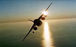 bomber aircraft makes a turn over the ocean