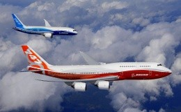 Two civilian Boeing 747 in sky blue and white-white-red