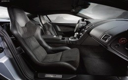 Aston Martin DBS car from the inside, seats, steering wheel, gear box.