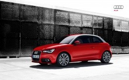Audi A1, photo red car, side view.