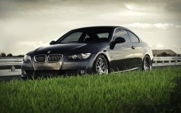 Black BMW and green grass, car wallpaper photo