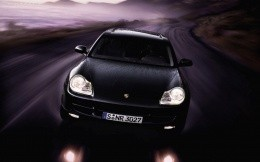 Black car Porshe - photo was taken at a high speed for a desktop
