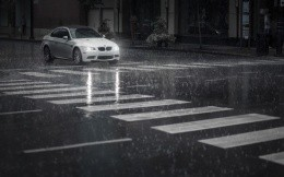 BMW 3 Series on a wet city street
