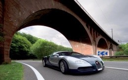Bugatti car on a background of greenery and stone bridge wallpaper.