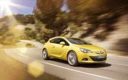 Photo Opel Astra OPC in yellow on a mountain streamer