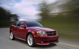 Photo red Dodge car in motion