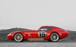 Photos of red sports car Shelby Daytona Coupe side view.