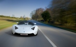 Russian supercar Marussia white on the road