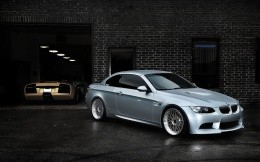 Silver BMW near the underground garage, photo wallpapers for your desktop
