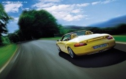 Sports car on a country road - background for your desktop