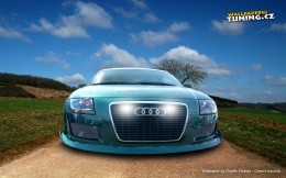 The modern car on a country road Audi - stylish wallpaper
