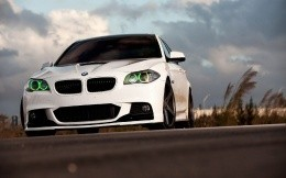 White BMW car with green illumination lights