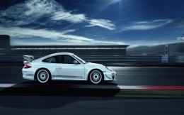 White Porsche RS 4.0 is a side view photo.