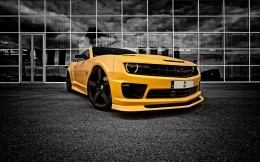Yellow Chevrolet Camaro in black and white