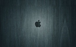 Apple logo on a wooden texture