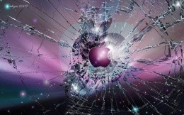 The Apple logo on the broken glass