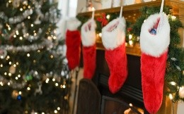 Red stockings on the fireplace with gifts, Christmas