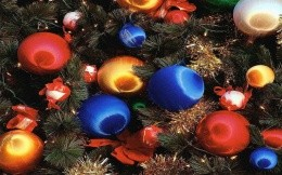 Spruce branches and christmas toy - a great Christmas theme for your desktop.