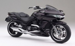 Black Honda motorcycle on a gray background wallpaper for your desktop.