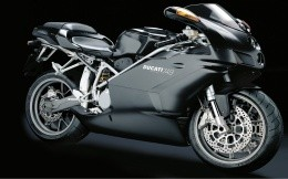Sporty black Ducati 749 motorcycle, wallpaper for your desktop.