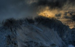 Mountains covered with clouds, a stunner and great wallpaper.