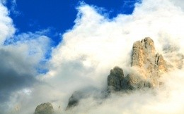 The mountain peaks in the clouds