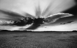 black and white picture of the clouds cover the sun