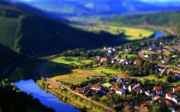 Photo-miniature village on the banks of the river