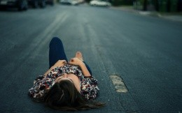 Girl lying on the road, a la Anna Karenina