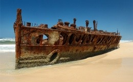 Rusted and Grounded old pirate ship on the island