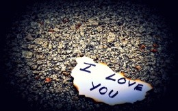 The theme of love, the words «i Love You» on a burnt piece of paper.