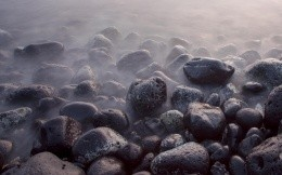 Smoke from the rocks at the seaside