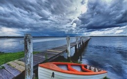 storm clouds boat