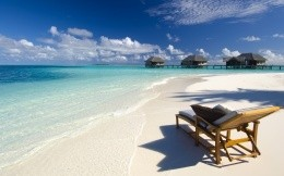 The beach in the Maldives and a chaise longue
