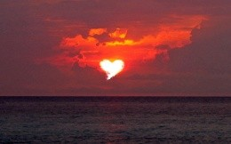 sunset over the sea, the sun in the form of heart