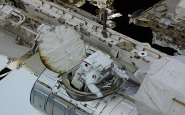 Astronaut in space station hatch
