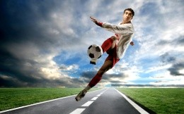 Footballer on the road