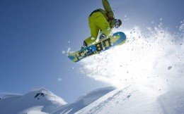 Jumping snowboarder photo below