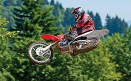 Moto freestyle, photo sportsman on a motorcycle Honda in the air.