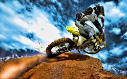 Moto trial, the driver at the next sharp turn, photo wallpaper