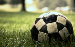 Soccer ball on the grass wallpaper