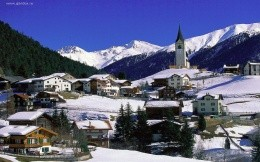 A small village in Switzerland, among snowy mountains wallpaper.