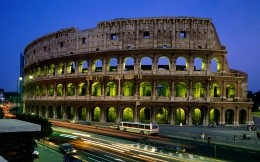 Coliseum in the light of evening city lights
