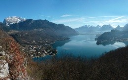 Lac Annecy, a small town in the mountains on the lake, photo wallpaper