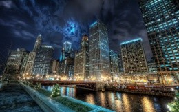 Panorama of night city with skyscrapers