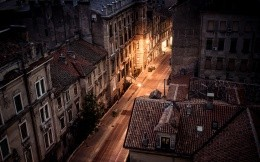 View of a street at night from the roof