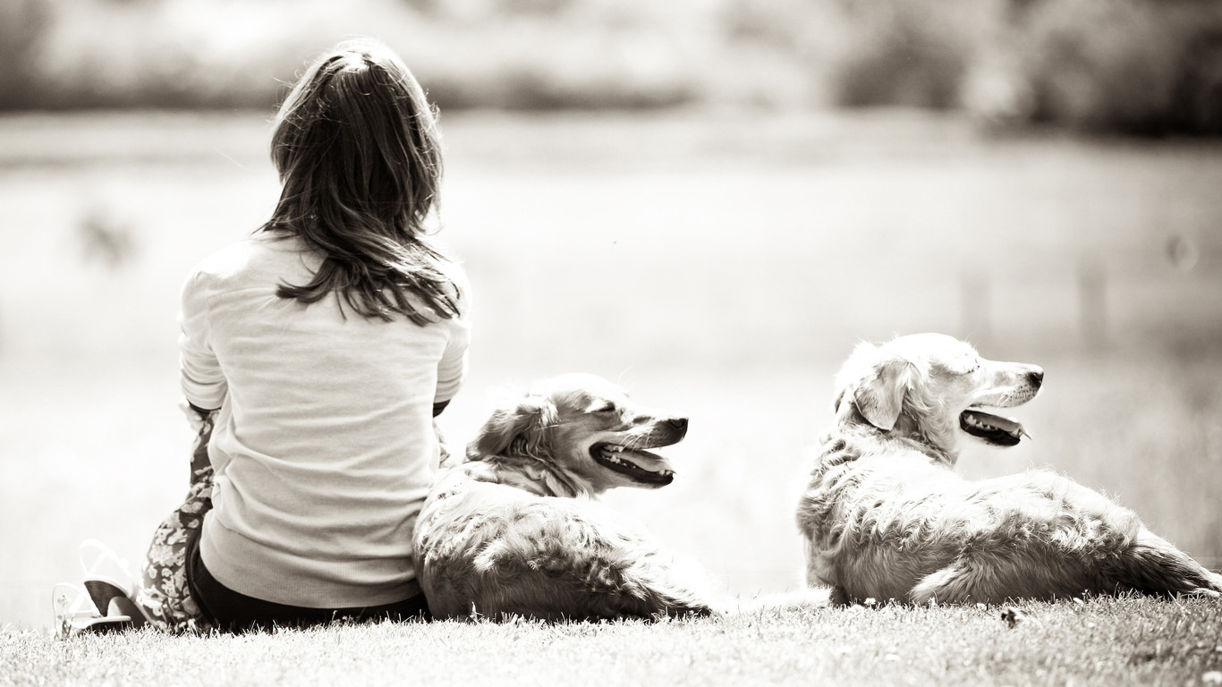Black and white photo of a girl and a dog