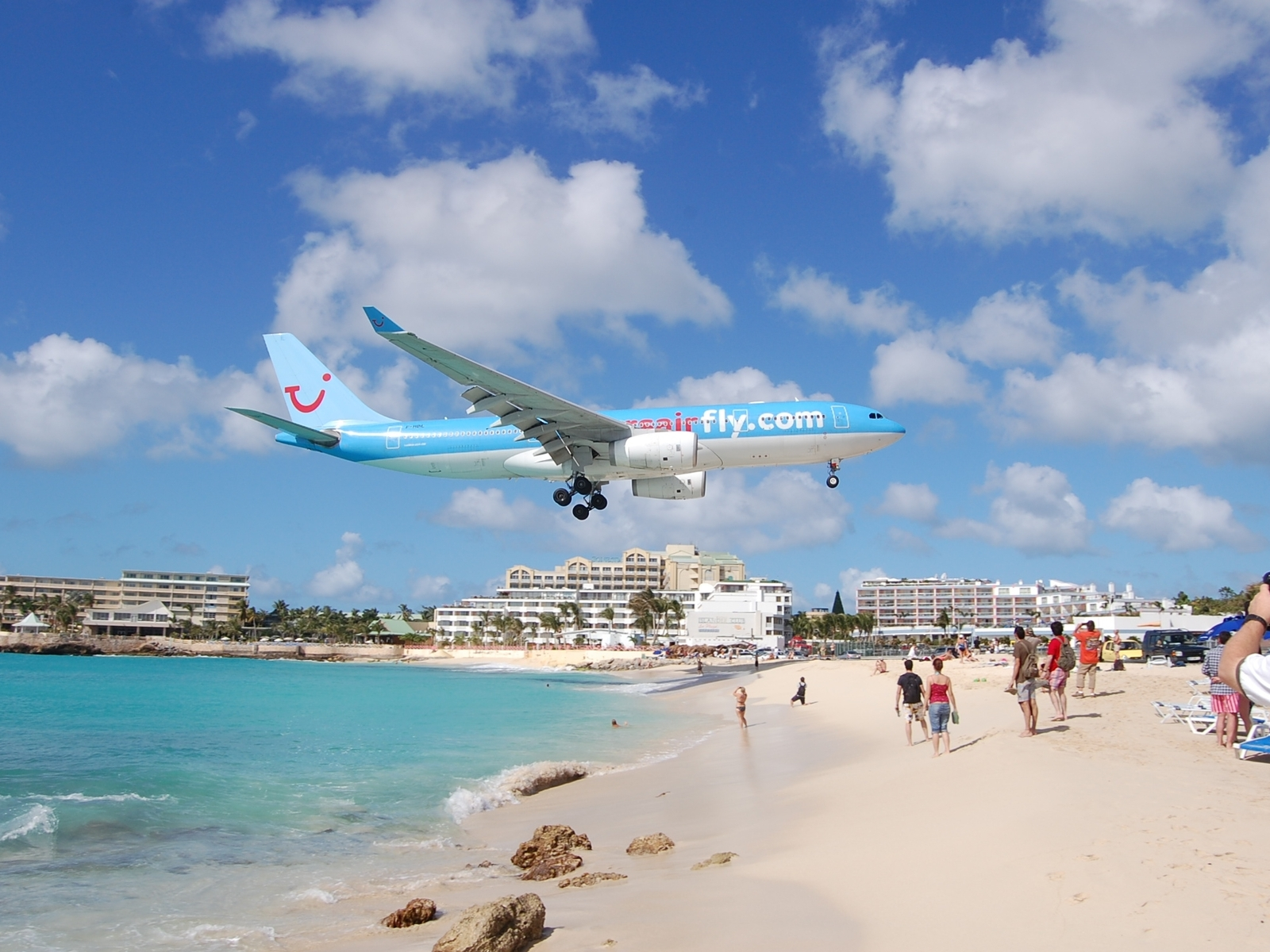 Airplane above the beach