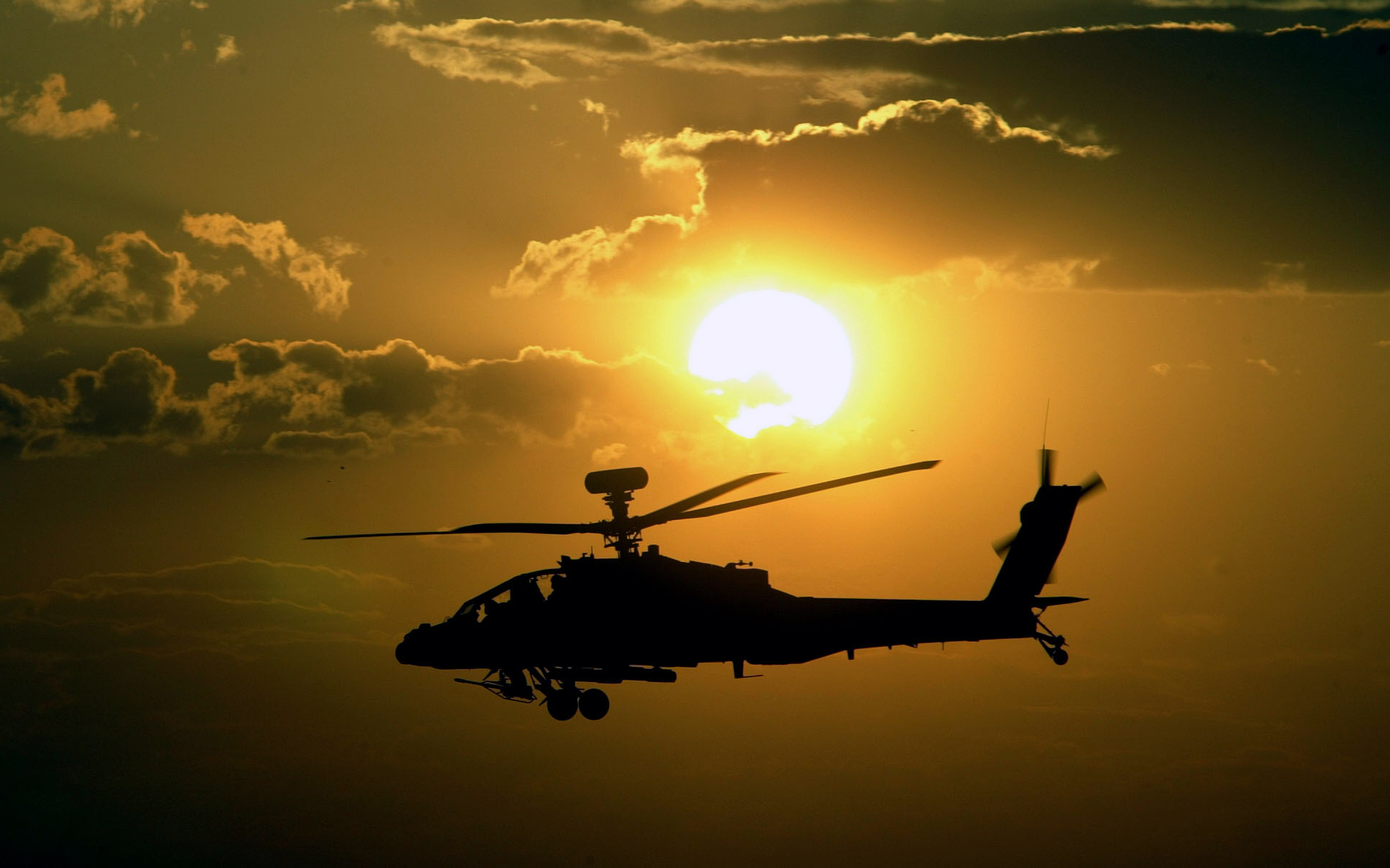 Military helicopter at sunset